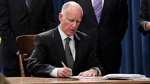 picture of Governor Brown Signing Document